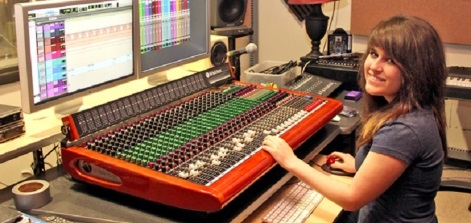 A student at a sound board.