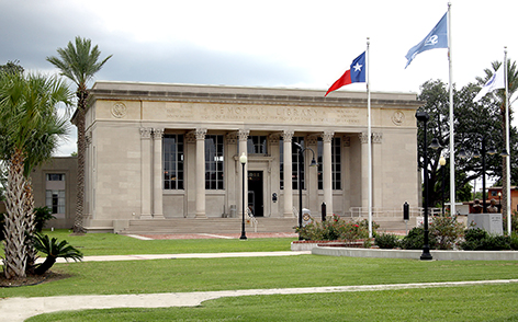 The library building with three flags in front.