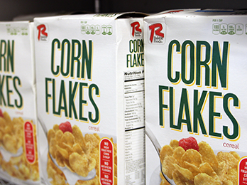 Corn Flakes Cereal Boxes on Shelf