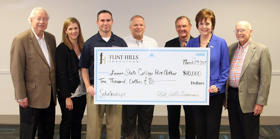 LSCPA and Flint Hills representatives holding a large check for $10,000